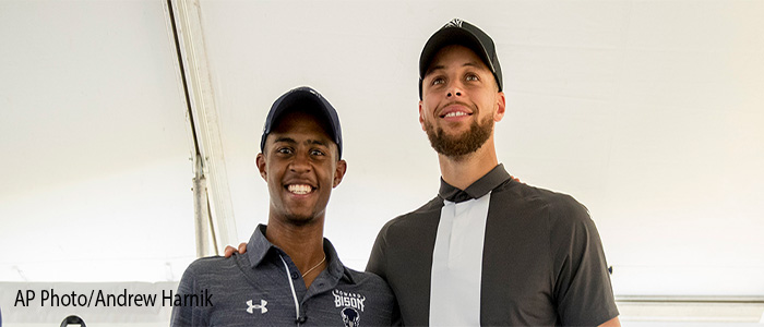 Golden State Warriors guard Stephen Curry, right, and Howard student Otis Ferguson