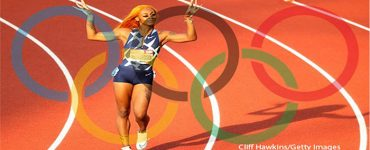 Sha'Carri Richardson: known for her long nails and her colorful hair on the field is a Black-American track and field sprinter superimposed against Olympic Rings