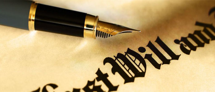 Image of pen signing a last will